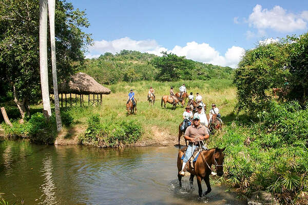 Riding Criollo horses in Cuba
