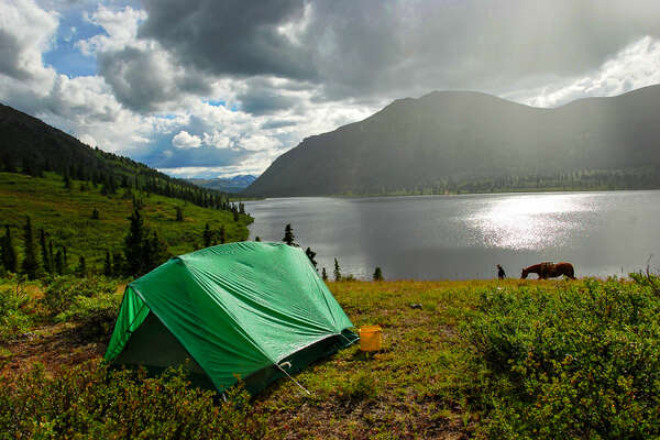 Rustic camping by a lake in the Yukon