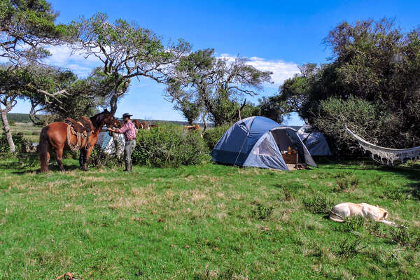 Setting camp after a day in the saddle