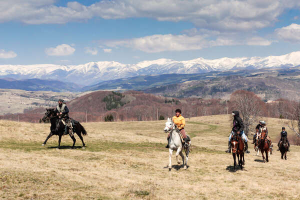 Trail riders against the backdrop of the Bulgarian mountains