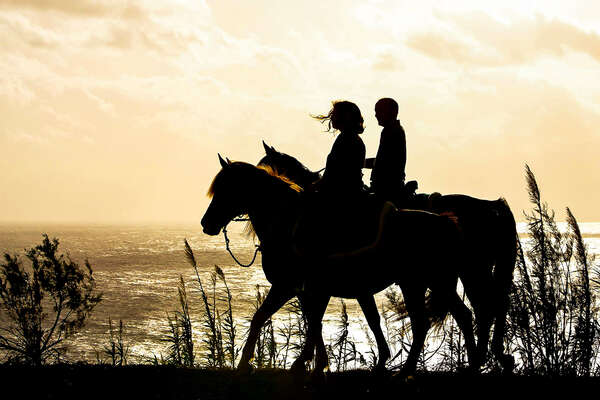 Trail riders as the sun sets on the Azores