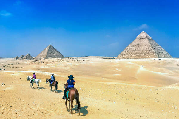Trail riders on a horseback vacation in Egypt
