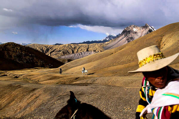 Trail riding on horseback in Peru
