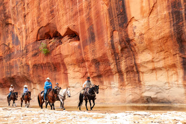 Trail riding through a canyon in America