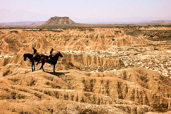Trail riding through the Bardenas desert in Spain