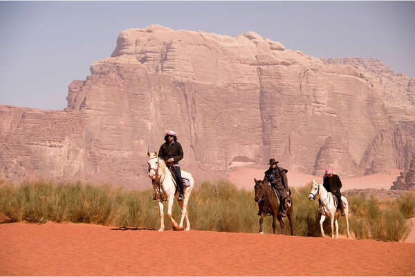 Trail riding through the Wadi Rum Desert