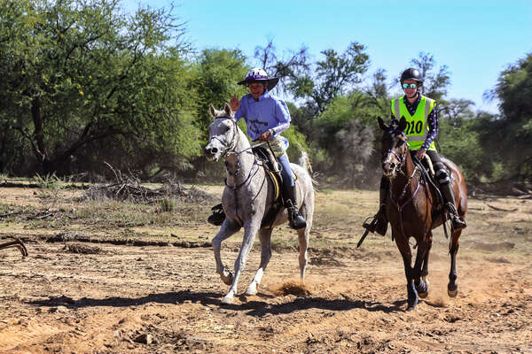 Two contestants in an endurance race on horseback in Namibia